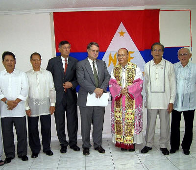 Delegates from the Netherlands, the Philippine government, the Catholic Church, and progressive organizations, during the opening of the NDFP office in Quezon City back in 2004 for the peace talks (photo courtesy of Arkibong Bayan).