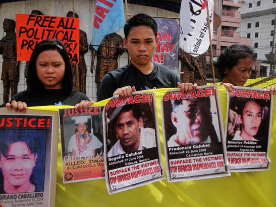 Filipinos in Manila in 2010 during the anniversary of the assassination of President Noynoy Aquino's father, Ninoy, asking the president to move against human rights violators in the Philippines (photo courtesy of Bulatlat).