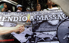 Members of KMP at a rally at Mendiola Bridge near Malacañang to commemorate the killing of 13 demonstrators at the same spot 26 years before (photo by AP courtesy of Business Mirror).