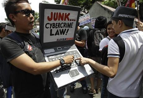 Protesters from the national democratic partylist, Bayan Muna, outside of the Supreme Court last October (photo from AP).