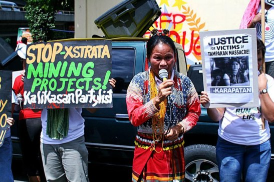 Members of Kalikasan Partylist and Lumad tribal members protesting the presence of Xstrata-SMI mining company in their community which lead to the deaths of multiple members of the Capion family (photo courtesy of BAYAN-Europe).