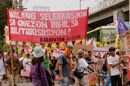 Karapatan-Quezon during a rally condemning the increasing militarization of Quezon Province (photo by Southern Tagalog Exposure).