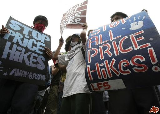 Filipino youth protesting utility price hikes and costs back in 2011 (photo by Bullit Marquez/AP).