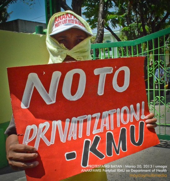 Workers from KMU unions protesting the rising privatization schemes by president Aquino (photo by