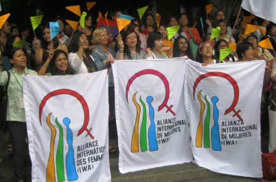 Grass-roots organizers posing for a photograph during the 1st International Assembly of the International Women's Alliance (photo courtesy of International Women's Alliance/Bulatlat).