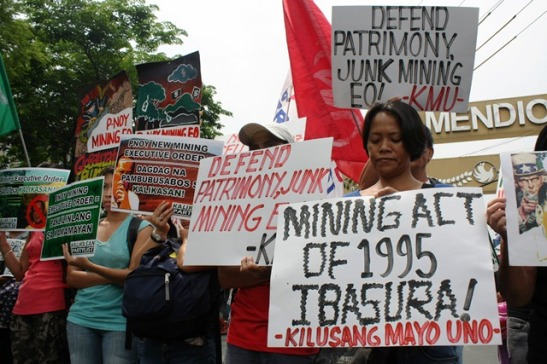 Workers protesting the Mining Act of 1995 last July (photo by Jhun Dantes/Bulatlat).