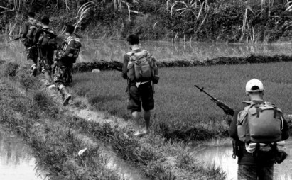 NPA on patrol in the rice paddies (photo courtesy of InterAksyon)