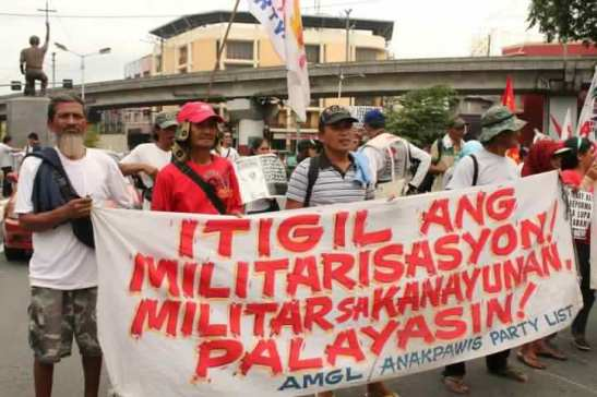 Members of Anakpawis Partylist calling for an end to the militarization of their communities (photo courtesy of Anakpawis).