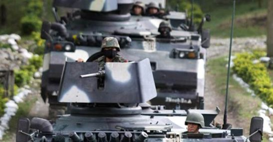 AFP armored units in Talayan, Maguindanao (photo by Mark Navales/Agence France-Presse).