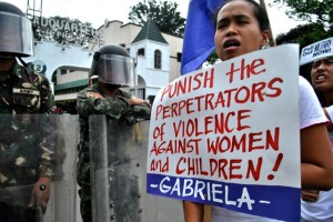 A protest being led by Gabriela condemning the AFP for its persistent violation of women's and children's rights (photo by Macky Macaspac/Pinoy Weekly).