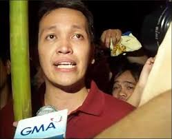 Bayan secretary-general, Renato Reyes, being interviewed at a protest near the US embassy back in 2009 (photo courtesy of Philippine Inquirer).