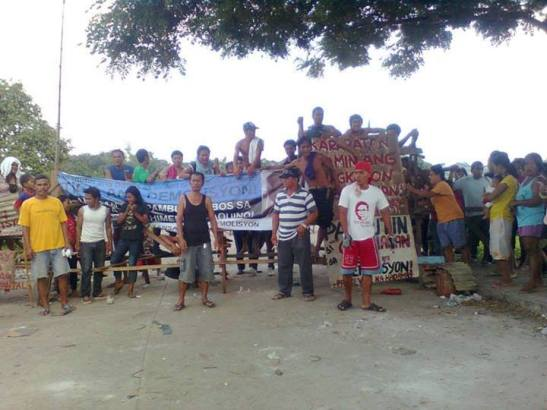 Urban poor residents of Barangay Bignay, Valenzuela defending their community from demolition on June 28th (photo courtesy of Kadamay-NCR).