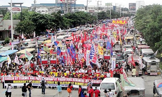 Protestors during last year's Peoples' SONA, organized by BAYAN, on Commonwealth Ave where razor wire is being placed along for Monday (photo courtesy of Arkibong Bayan).