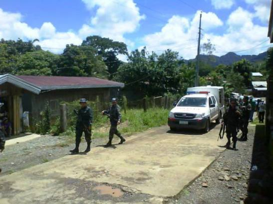 A Philippine National Police patrol in an area affected by large scale mining (photo courtesy of Bulatlat).