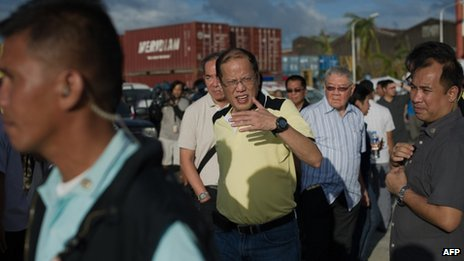 President Aquino in one of the areas hit by the supertyphoon (photo courtesy of Agence France-Presse).