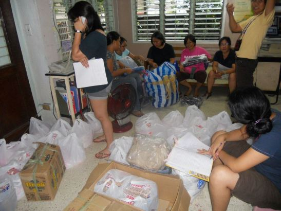 Organizers from the national democratic women's alliance, Gabriela, organizing for their relief operations (photo courtesy of Gabriela Philippines).
